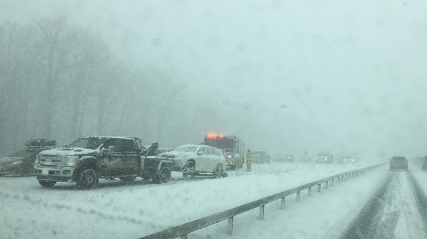 A tow truck is seen on Highway 400 after several collisions occurred in Barrie on Jan. 1, 2018. (Barrie Police)