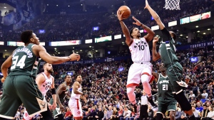 Toronto Raptors guard DeMar DeRozan (10) shoots over Milwaukee Bucks forward John Henson (31) during first half NBA basketball action in Toronto on Monday, January 1, 2018. THE CANADIAN PRESS/Frank Gunn