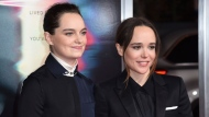 "In this Sept. 27, 2017 file photo, Emma Portner, left, and Ellen Page arrive at the world premiere of ""Flatliners"" at The Theatre at Ace Hotel in Los Angeles. (Photo by Richard Shotwell/Invision/AP, File)"