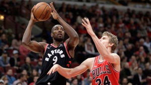 Toronto Raptors' Serge Ibaka (9) shoots over Chicago Bulls' Lauri Markkanen during the first half of an NBA basketball game Wednesday, Jan. 3, 2018, in Chicago. (AP Photo/Charles Rex Arbogast)