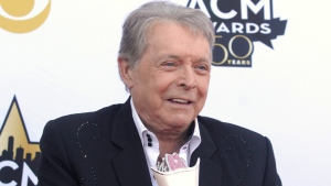 In this April 19, 2015 file photo, Mickey Gilley poses with the triple crown award on the red carpet at the 50th annual Academy of Country Music Awards at AT&T Stadium in Arlington, Texas. Country music artist Gilley and his son were injured in a car accident in Texas, but both are recovering after minor injuries. A statement from Gilley's publicist on Thursday, Jan. 4, 2018, said the two were injured Wednesday when their car rolled over. (Photo by Jack Plunkett/Invision/AP, File)