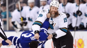 San Jose Sharks' Joe Thornton, right, fights with Toronto Maple Leafs' Nazem Kadri during first period NHL hockey action, in Toronto on Thursday, January 4, 2018. THE CANADIAN PRESS/Frank Gunn