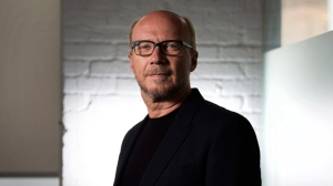 "In this Sept. 6, 204 file photo, director Paul Haggis poses for a photo in Toronto during the 2014 Toronto International Film Festival. A December 2017 civil lawsuit charging the Oscar-winning filmmaker with rape has prompted three other women to come forward with their own accusations, including a publicist who says he forced her to perform oral sex, then raped her. Haggis has denied the allegations in the lawsuit, and when asked about the new accusations, his lawyer said, ""He didn't rape anybody."" (AP Photo/The Canadian Press, Darren Calabrese, File)"