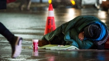 A homeless person is seen in downtown Toronto, on Wednesday, January 3, 2018. (THE CANADIAN PRESS/Christopher Katsarov)