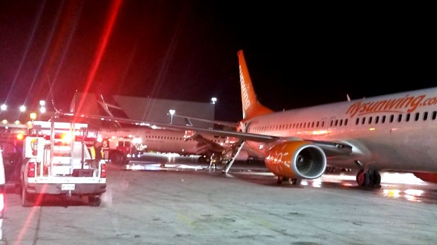 Passengers evacuate burning plane after crash at airport