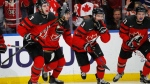 Canada celebrates a goal against Sweden during the second period of the title game of the IIHF world junior hockey championships Friday, Jan. 5, 2018, in Buffalo, N.Y. (AP Photo/Jeffrey T. Barnes)