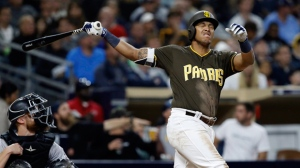San Diego Padres' Yangervis Solarte, right, reacts after hitting a fly ball for an out to center field, with catcher Jonathan Lucroy, left, watching during the sixth inning of a baseball game in San Diego, Friday, Sept. 22, 2017. (AP Photo/Alex Gallardo)
