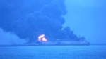 In this photo provided by Korea Coast Guard, the Panama-registered tanker 'Sanchi' is seen ablaze after a collision with a Hong Kong-registered freighter off China's eastern coast Sunday, Jan. 7, 2018. (Korea Coast Guard via AP)