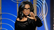 This image released by NBC shows Oprah Winfrey accepting the Cecil B. DeMille Award at the 75th Annual Golden Globe Awards in Beverly Hills, Calif., on Sunday, Jan. 7, 2018. (Paul Drinkwater/NBC via AP)