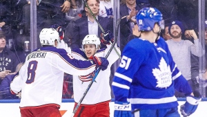 Columbus Blue Jackets left wing Artemi Panarin (9) celebrates with defenceman Zach Werenski (8) after scoring the game wining goal as Toronto Maple Leafs defenceman Jake Gardiner (51) looks back during the overtime period of NHL hockey action in Toronto on Monday, January 8, 2018. THE CANADIAN PRESS/Chris Young
