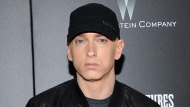 "FILE - In this July 20, 2015, file photo, Rapper Eminem attends the premiere of ""Southpaw"" in New York. Eminem, The Killers, Muse, Future, Bassnectar and Sturgill Simpson lead the lineup for the Bonnaroo Music and Arts Festival this June in Tennessee. The festival announced on Tuesday, Jan. 9, 2018, their lineup for the music festival in Manchester, June 7 -10. (Photo by Evan Agostini/Invision/AP, File)"