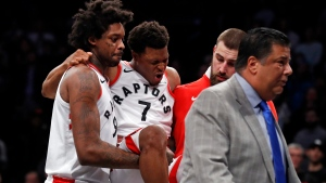 Toronto Raptors guard Kyle Lowry (7) reacts as he is carried off by teammates during the second half of an NBA basketball game against the Brooklyn Nets, Monday, Jan. 8, 2018, in New York. (AP Photo/Adam Hunger)