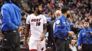 Miami Heat forward James Johnson (16) is ejected from the game along with Toronto Raptors forward Serge Ibaka (not shown) during second half NBA basketball action in Toronto on Tuesday, January 9, 2018. THE CANADIAN PRESS/Nathan Denette