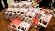 "Copies of Michael Wolff's ""Fire and Fury: Inside the Trump White House"" on display as they go on sale at a bookshop, in London, Tuesday, Jan. 9, 2018. A trade magazine is reporting that over 1 million orders for the book have been placed in the United States alone. This consignment of 500 copies are the only books available in shops in the United Kingdom on Tuesday. (AP Photo/Alastair Grant)"