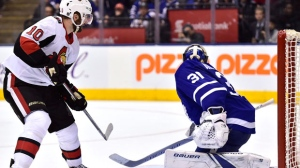 Ottawa Senators left wing Tom Pyatt (10) scores against Toronto Maple Leafs goaltender Frederik Andersen (31) during third period NHL hockey action in Toronto on Wednesday, January 10, 2018. THE CANADIAN PRESS/Frank Gunn