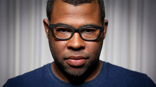 "In this Thursday, Feb. 9, 2017 photo, Jordan Peele poses for a portrait at the SLS Hotel in Los Angeles. Peele's directorial debut, ""Get Out,"" in theaters Friday, Feb. 24, is one of those rare creations that functions both as a taut psychological thriller and as searing social commentary about racism in the modern era. (Photo by Rich Fury/Invision/AP)"