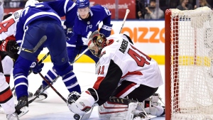 Ottawa Senators goaltender Craig Anderson (41) makes a save in front of Toronto Maple Leafs left wing James van Riemsdyk (25) and centre Tyler Bozak (42) during second period NHL hockey action in Toronto on Wednesday, January 10, 2018. THE CANADIAN PRESS/Frank Gunn