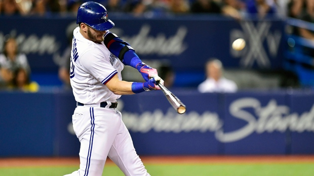 In this Aug. 15, 2017, file photo, Toronto Blue Jays' Josh Donaldson hits a three-run home run against the Tampa Bay Rays during the fifth inning of a baseball game in Toronto. The hot corner figures to be smoking Friday, Jan. 12, 2018, when players and team swap proposed salaries in arbitration. Donaldson, Baltimore's Manny Machado, Washington's Anthony Rendon and the Chicago Cubs' Kris Bryant were among the more than 170 players headed to the exchange. (Frank Gunn/The Canadian Press via AP, File)