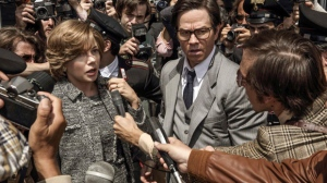 "This image released by Sony Pictures shows Michelle Williams, left, and Mark Wahlberg in TriStar Pictures' ""All The Money in the World."" After an outcry over a significant disparity in pay with Williams, Wahlberg has agreed to donate the $1.5 million he earned for reshoots on the movie to the anti-sexual misconduct initiative Time's Up, in Williams' name, announced Saturday, Jan. 13, 2018. (Fabio Lovino/Sony-TriStar Pictures via AP)"