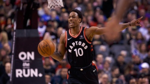 Toronto Raptors' DeMar DeRozan (10) takes the ball up the court during first half NBA basketball action against the Golden State Warriors in Toronto on Saturday, January 13, 2018. THE CANADIAN PRESS/Cole Burston