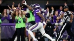 Minnesota Vikings wide receiver Stefon Diggs (14) runs in for a game winning touchdown against the New Orleans Saints during the second half of an NFL divisional football playoff game in Minneapolis, Sunday, Jan. 14, 2018. The Vikings defeated the Saints 29-24. (AP Photo/Jeff Roberson)