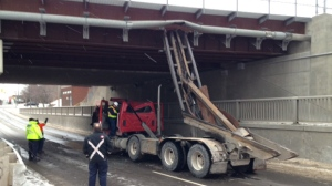 A section of Martin Grove Road is shut down after a truck struck a bridge in Rexdale on Monday morning. (Cam Woolley/ CP24)