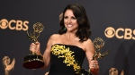 "In this Sunday, Sept. 17, 2017 file photo, Julia Louis-Dreyfus poses in the press room with her awards for outstanding lead actress in a comedy series and outstanding comedy series for ""Veep"" at the 69th Primetime Emmy Awards at the Microsoft Theater in Los Angeles. (Photo by Jordan Strauss/Invision/AP)"