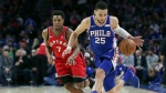 Philadelphia 76ers guard Ben Simmons (25) loses the ball but regains possession as Toronto Raptors guard Kyle Lowry (7) defends during the third quarter of an NBA basketball game in Philadelphia, Monday, Jan. 15, 2018. The 76ers won 117-111. (AP Photo/Rich Schultz)