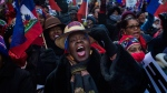 Gretha, a nurse from Haiti and resident of New York, 66, shouts slogans during a rally against racism in opposition to President Donald Trump's recent disparaging comments about Haiti and African nations in Times Square in New York, on Monday, Jan. 15, 2018. (AP Photo/Andres Kudacki)