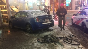 Police say only minor damage was reported after a car collided with a building near Dundas and Victoria streets. (Mike Nguyen/ CP24)