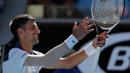 Serbia's Novak Djokovic celebrates after defeating United States' Donald Young during their first round match at the Australian Open tennis championships in Melbourne, Australia, Tuesday, Jan. 16, 2018. (AP Photo/Dita Alangkara)