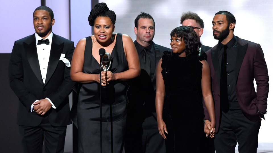 "Courtney Kemp Agboh, and the cast and crew of ""Power"" accept the award for outstanding drama series at the 49th annual NAACP Image Awards at the Pasadena Civic Auditorium on Monday, Jan. 15, 2018, in Pasadena, Calif. (Photo by Chris Pizzello/Invision/AP)"