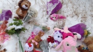 A memorial grows near a Downsview school where a five-year-old girl was killed after being pinned between two vehicles on Monday afternoon. (Cam Woolley/ CP24)