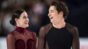 Tessa Virtue and Scott Moir skate off the ice after performing their free dance during the senior ice dance competition at the Canadian Figure Skating Championships in Vancouver, B.C., on Saturday January 13, 2018. THE CANADIAN PRESS/Jonathan Hayward
