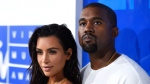 FILE - In this Aug. 28, 2016 file photo, Kim Kardashian West, left, and Kanye West arrive at the MTV Video Music Awards in New York. Kardashian West announced on her app Tuesday, Jan. 16, 2018. the birth of their daughter via surrogate The baby, their third, was born early Monday and weighed in at 7 pounds, 6 ounces. (Photo by Evan Agostini/Invision/AP, File)