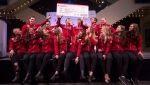 Members of the Olympic speedskating team for Team Canada have some fun with a plane ticket to Korea after being named to Canada's Olympic team in Calgary, Wednesday, Jan. 10, 2018.THE CANADIAN PRESS/Todd Korol