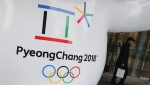 FILE - In this Thursday, Jan. 4, 2018, file photo, the official emblem of the 2018 Pyeongchang Olympic Winter Games is seen in downtown Seoul, South Korea.  (AP Photo/Lee Jin-man, File)