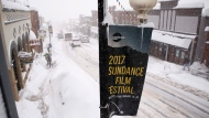 Heavy snow falls along Main Street during the 2017 Sundance Film Festival on in Park City, Utah on January 23, 2017. THE CANADIAN PRESS/AP, Invision - Danny Moloshok