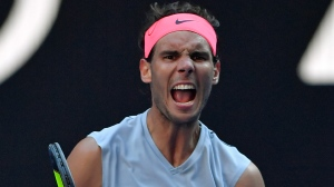 Spain's Rafael Nadal celebrates a point win over Argentina's Leonardo Mayer during their second round match at the Australian Open tennis championships in Melbourne, Australia, Wednesday, Jan. 17, 2018. (AP Photo/Andy Brownbill)