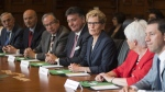 Ontario Premier Kathleen Wynne holds the first cabinet meeting after the announcement of a cabinet shuffle at Queen's Park in Toronto on June 13 , 2016. Premier Kathleen Wynne is shuffling several senior portfolios in her cabinet, less than five months before the Ontario election, The Canadian Press has learned.Deputy Premier and Advanced Education Minister Deb Matthews, Treasury Board President Liz Sandals and Economic Development Minister Brad Duguid have all said they're not running in the June election, and Wynne is filling those jobs with politicians who are up for re-election. THE CANADIAN PRESS/Eduardo Lima