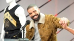 Canadian rap star Drake reacts during a press conference where his OVO uniforms were unveiled ahead of NBA basketball action between the Toronto Raptors and Detroit Pistons in Toronto on Wednesday, January 17, 2018. The Raptors and Canadian rap star Drake announced plans to grow their partnership Wednesday with a new program called Welcome Toronto. Raptors president Masai Ujiri and Drake -- who has served as the team's global ambassador since 2013 -- announced the program before the Raptors' home game against the Detroit Pistons. THE CANADIAN PRESS/Frank Gunn