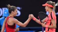 Romania's Simona Halep, left, shakes hands with Canada's Eugenie Bouchard as Halep won their second round match at the Australian Open tennis championships in Melbourne, Australia, Thursday, Jan. 18, 2018. (AP Photo/Andy Brownbill)