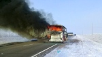 In this Kazakhstan Ministry for Emergency Situations photo, made available on Thursday, Jan. 18, 2018, a bus burns on a road in near the village of Kalybai in Kazakhstan. Kazakhstan's emergency officials say 52 people of 57 on the bus died on the fire. (Kazakhstan Ministry for Emergency Situations via AP)