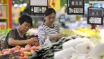 In this Sept. 9, 2017 photo, women shop for produce at a supermarket in Fuyang in central China's Anhui province. (Chinatopix via AP)