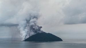 In this photo taken on Tuesday, Jan. 16, 2018, ash plumes rise from the volcano on Kadovar Island, Papua New Guinea in the South Pacific. Seismic activity beneath a Papua New Guinea volcano could mean a major eruption is imminent. Thousands of people have been evacuated from islands surrounding Kadovar Island, where a volcano has been erupting since Jan. 5. (Brenton-James Glover via AP)