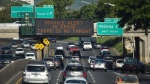"In this Saturday, Jan. 13, 2018 file photo provided by Civil Beat, cars drive past a highway sign that says ""MISSILE ALERT ERROR THERE IS NO THREAT"" on the H-1 Freeway in Honolulu. Gov. David Ige has appointed state Army National Guard Brig. Gen. Kenneth Hara as new head of Hawaii's emergency management agency after a faulty alert was sent to cellphones around the state warning of an incoming missile attack. (Cory Lum/Civil Beat via AP, file)"