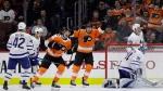 Philadelphia Flyers' Nolan Patrick (19) and Michael Raffl (12) celebrate after Patricks' goal against Toronto Maple Leafs' Frederik Andersen (31) during the third period of an NHL hockey game, Thursday, Jan. 18, 2018, in Philadelphia. (AP Photo/Matt Slocum)