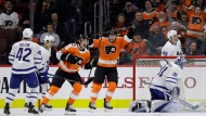 Philadelphia Flyers' Nolan Patrick (19) and Michael Raffl (12) celebrate after Patricks' goal against Toronto Maple Leafs' Frederik Andersen (31) during the third period of an NHL hockey game, Thursday, Jan. 18, 2018, in Philadelphia. (AP Photo/Matt Slocum)