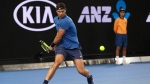 Spain's Rafael Nadal makes a backhand return during a practice match against Austria's Dominic Thiem on Margaret Court Arena ahead of the Australian Open tennis championships in Melbourne, Australia Friday, Jan. 12, 2018. (AP Photo/Mark Baker)