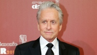 "In this Feb. 26, 2016 file photo, U.S actor Michael Douglas arrives at the 41st French Cesar Awards Ceremony, in Paris. A woman who worked for  Douglas in the late 1980s says he fondled himself in front of her, an allegation the actor has vigorously denied. Journalist and author Susan Braudy appeared Friday, Jan. 19, 2018 on NBC's ""Today"" show. Earlier this month, Douglas said he anticipated an upcoming report containing allegations and called it a ""complete lie, fabrication.""(AP Photo/Thibault Camus, File)"